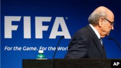 FILE - FIFA President Sepp Blatter is seen leaving a podium.