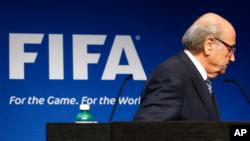 FILE - FIFA President Sepp Blatter is seen leaving a podium.