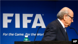 FIFA TIMELINE - Blatter leaves podium