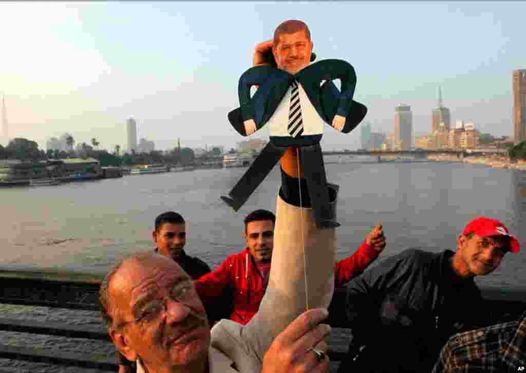 Egyptian artist Mohammed Darwish with a puppet of President Mohamed Morsi during an anti-Muslim Brotherhood protest on Qasr El-Nile Bridge in Cairo, February 10, 2013.