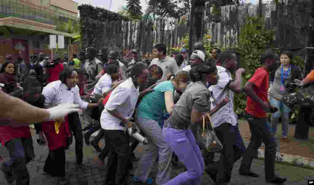 Civilians who had been hiding inside during the gun battle manage to flee from the Westgate Mall in Nairobi, Sept. 21, 2013.