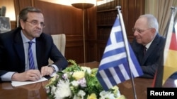 German Finance Minister Wolfgang Schaeuble (R) meets Greek Prime Minister Antonis Samaras in Athens, July 18, 2013.