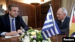 Bộ trưởng Tài chính Đức Wolfgang Schaeuble ([phải) gặp Thủ tướng Hy Lạp Antonis Samaras tại Athens, ngày 18/7/2013.