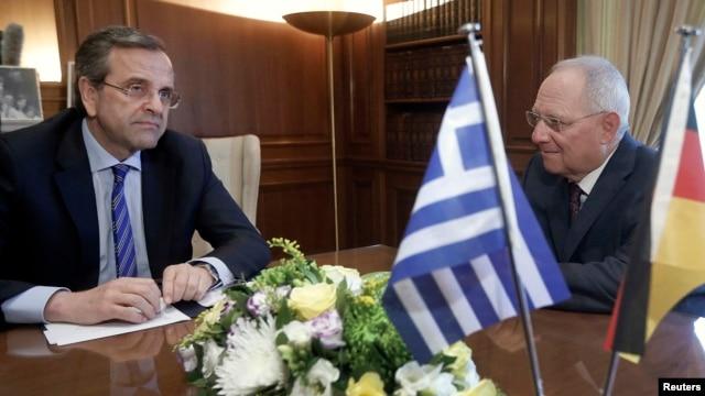 German Finance Minister Wolfgang Schaeuble (R) meets Greek Prime Minister Antonis Samaras in Athens, July 18, 2013.