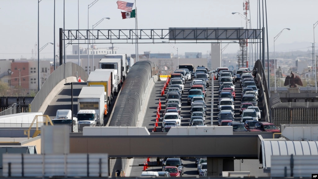 FILE - In this March 29, 2019, photo, cars and trucks line up to enter the U.S. from Mexico at a border crossing in El Paso, Texas. A 2½-year-old Guatemalan child has died after crossing the border, becoming the fourth minor known to have died after being