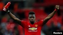 Paul Pogba dari Manchester United melakukan selebrasi di penghujung pertandingan, 13 Januari 2019. (Foto: REUTERS/Eddie Keogh)