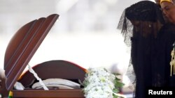 FILE: Former first lady of Zimbabwe, Grace Mugabe, pays her last respects during a state funeral of her husband and the country's longtime ruler Robert Mugabe, at the national sports stadium in Harare, Sept. 14, 2019.