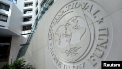 FILE - The International Monetary Fund logo is seen inside its headquarters at the end of the IMF/World Bank annual meetings in Washington.