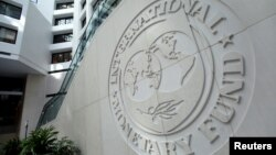FILE - The International Monetary Fund logo is seen inside its headquarters at the end of the IMF/World Bank annual meetings in Washington, Oct. 9, 2016.