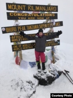 Montannah Kenney, 7, of Texas reaches the top of Mt. Kilimanjaro. (Photo courtesy of Hollie Kenney)