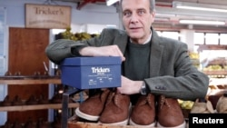 Martin Mason, managing director of British luxury shoemaker Trickers poses for an interview where he discusses EU customers affected by new tax costs and an increase in product returns, in Northampton, Britain, January 25, 2021. (REUTERS/Matthew Childs)