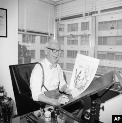 Cartoonist Rube Goldberg, 81, is shown in his New York City apartment, April 24, 1964 after he completed his last cartoon.