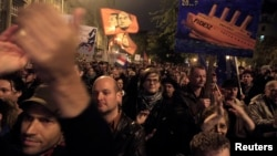 Thousands of Hungarians rally against perceived corruption and for broader freedoms at the country's tax authority in Budapest, Nov. 9, 2014.