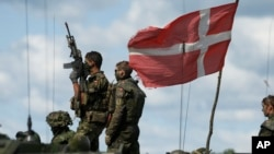 Danish soldiers participate in the annual multinational NATO exercise in the Baltic states on June 17, 2014.