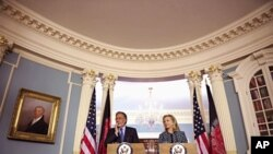 U.S. Secretary of State Hillary Clinton and Afghan Foreign Minister Zalmai Rassoul meet with reporters at the State Department in Washington, March 21, 2012