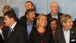 EU foreign policy chief Federica Mogherini , center, smiles, during the Informal Meeting of EU Foreign Ministers in Bratislava, Slovakia, Sept. 3, 2016.