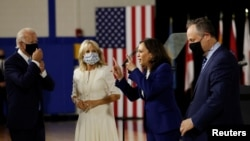 From left, Democratic presidential candidate Joe Biden, his wife, Jill Biden, vice presidential candidate Kamala Harris and her husband, Douglas Emhoff, at Alexis Dupont High School in Wilmington, Delaware, Aug. 12, 2020.