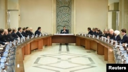 FILE - Syria's President Bashar al-Assad heads a meeting of his cabinet in Damascus.