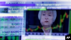 The news conference of Federal Reserve Chair Janet Yellen is reflected in a specialist's screen on the floor of the New York Stock Exchange, Wednesday, June 15, 2016. (AP Photo/Richard Drew)