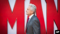 Michael Douglas poses for photographers upon arrival at the premiere of the film Ant Man in London, Wednesday, July 8, 2015.