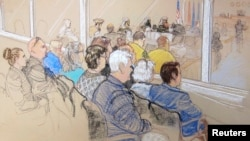 Family members of victims and Office of Military Commissions staff watch pretrial hearings for alleged conspirators in the 9/11 attacks, Guantanamo Bay, Cuba, Jan. 28, 2013.