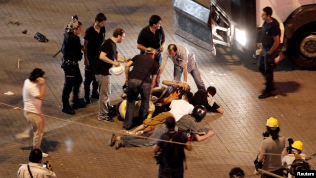 Protesters are detained by plainclothes police  during an anti-government protest at Taksim Square in Istanbul, June 29, 2013.