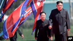 North Korean leader Kim Jong Un, right, and Choe Ryong Hae, vice-chairman of the central committee of the Workers' Party, arrive for the official opening of the Ryomyong residential area, in Pyongyang, North Korea, April 13, 2107.