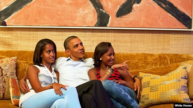 President Barack Obama and his daughters, Malia (l) and Sasha, watch on TV as First Lady Michelle Obama delivers her speech at the Democratic National Convention, Sept. 4, 2012. (Official White House Photo by Pete Souza)