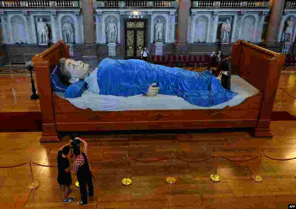 Ahead of a production by French theatre company Royal de Luxe, a giant puppet Grandmother is seen lying in a bed in St Georges Hall in Liverpool, north west England.