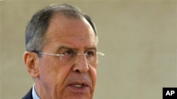 Russian Foreign Minister Sergey Lavrov speaks at an opening of a month-long session of the U.N. Human Rights Council in Geneva Monday, March 3, 2014. Lavrov on Monday justified the use of Russian troops streaming into neighboring Ukraine's Crimea region