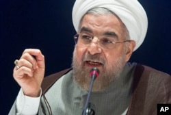 Iran's President Hassan Rouhani speaks during a news conference in New York, Sept. 26, 2014.