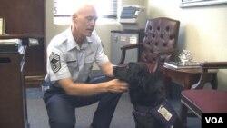 Chief Master Sgt. Richard Simonsen with his therapy dog, Yoko.