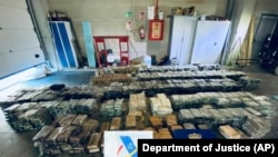 This May 2021 image from an affidavit for a search warrant, provided by the U.S. Department of Justice, shows cocaine that had been transported in hollowed-out pineapples from Costa Rica to Spain.