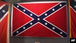 Confederate flags that once flew at the South Carolina Statehouse are displayed at the South Carolina State Museum, June 24, 2015, in Columbia.