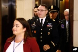 FILE - Army Lieutenant Colonel Alexander Vindman, a military officer at the National Security Council, center, arrives on Capitol Hill in Washington, Oct. 29, 2019.