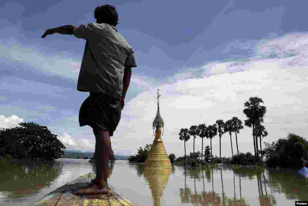 A pagoda seen in a flooded village at Kalay township at Sagaing division, Myanmar, Aug. 2, 2015.