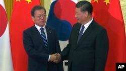 中國國家主席習近平在北京人大會堂會見到訪的南韓總統文在寅。(2019年12月23日)