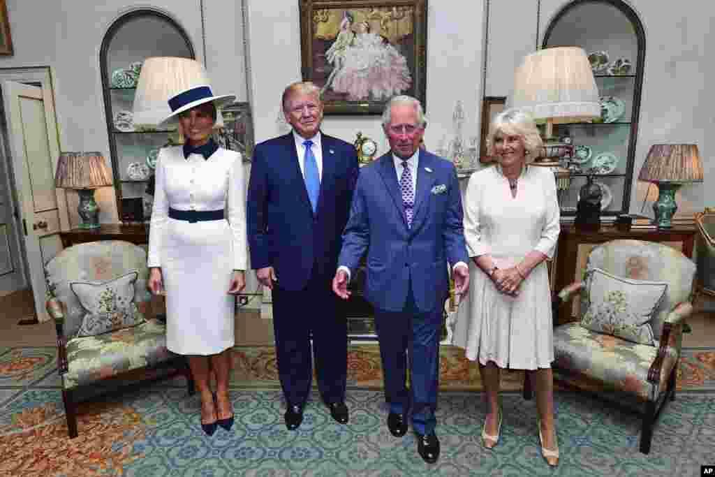 Ameriki predsednik Donald Tramp I Prva Dama SAD u društvu britanskog princa Čarlsa Kamile, vojvotkinje od Kornvola pred polazak u na tradicionalni britanski čaj u palati Klarens u Londonu. 3. juni, 2019.