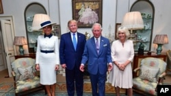 Predsednik Tramp i supruga Melanija sa princom Čarlsom i Kamilom, vojvotkinjom od Kornvola, 3. juna 2019.