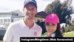 Minju Kim posed with Adam Scott recently in California. She is getting attention for a trick golf shot she made at a bowling alley.