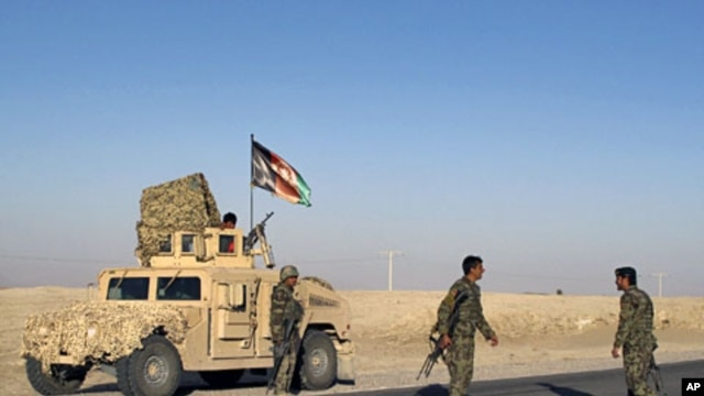 Afghan National Army soldiers arrive near the site of a blast in Helmand province, March 7, 2012