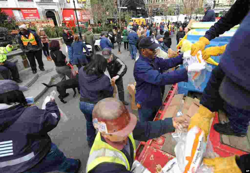 Dry ice is unloaded from a flatbed truck in Union Square for distribution to residents of the still powerless Chelsea section of Manhattan, Nov.1, 2012.