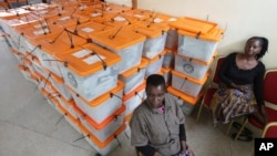 Polling agents guard ballot boxes as counting of ballot papers continues a day after presidential elections in Lusaka, Zambia, Jan, 21, 2015.