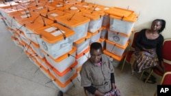 Polling agents guard ballot boxes as tallying continues a day after presidential elections, Lusaka, Zambia, Jan. 21, 2015.