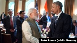 FILE - President Barack Obama and Indian Prime Minister Narendra Modi talk in the Cabinet Room of the White House, June 7, 2016.