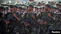 FILE - Members of Iran's Revolutionary Guards march during a military parade to commemorate the 1980-88 Iran-Iraq war in Tehran Sept. 22, 2007.