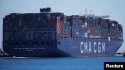 FILE - Containers are pictured on the Antoine de Saint Exupery, a cargo ship of French shipping company CMA CGM after leaving the port of Algeciras, Spain, May 31, 2018. CMA CGM said July 7, 2018, that it was pulling out of Iran for fear of becoming entangled in U.S.sanctions.