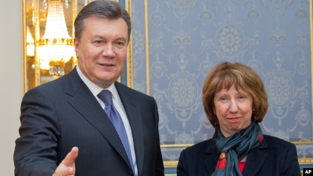 Ukrainian President Viktor Yanukovych, left,  greets EU foreign policy chief Catherine Ashton in Kiev, Ukraine, Tuesday, Dec. 10, 2013.