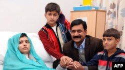 A handout picture received from the Queen Elizabeth Hospital/University Hospitals in Birmingham shows Pakistani schoolgirl Malala Yousafzai, and her family.