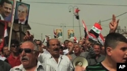 A rally in support of Syrian leader Bashar Al-Assad - on the Israeli side of the demilitarized zone